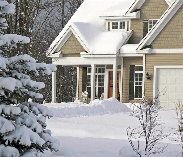 Image of house and yard covered with snow