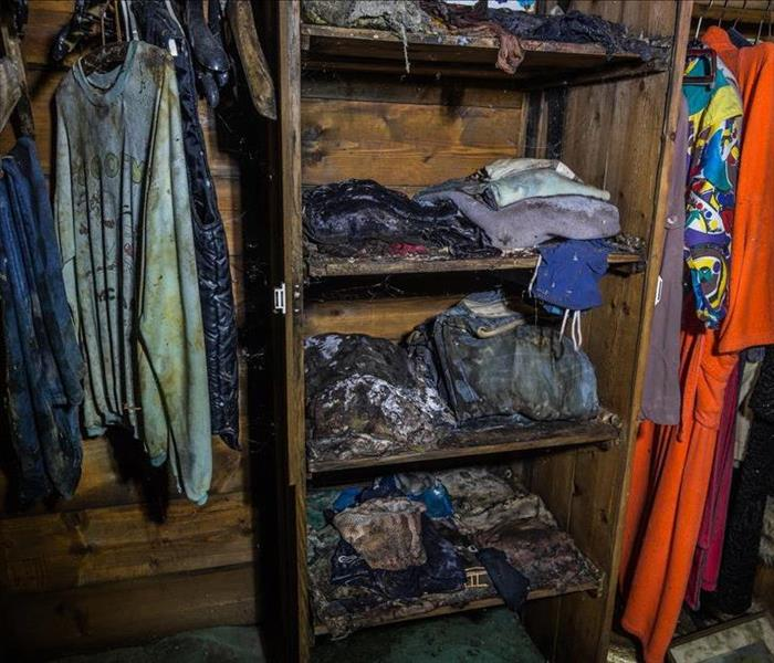 Image of closet and clothes full of mold